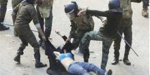 Women being dragged by military officers during the Egyptian revolution