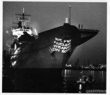 Projection on British aircraft carrier, by Greenpeace.